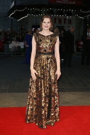 Geena Davis sparkled on the red carpet in a sequined gold gown during the BFI London Film Fest premiere of 'Suffragette.'