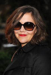 Maggie has the power to make a daytime outfit so glamorous with her effortless side-swept waves and Hollywood shades.
