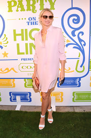 Naomi Watts sported a pale pink shirtdress while at the Coach Summer Party on the Highline.