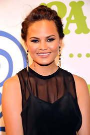 Chrissy Teigen's pinned updo looked super chic on the stunning model.