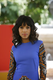 Kerry Washington arrived at a photocall for 'Django Unchained' wearing her shoulder-length tresses in casually tousled waves with long brow-grazing bangs.
