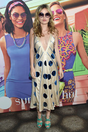 Georgia May Jagger donned a dangerously low-cut polka-dot dress for the Electrify Your Summer event.