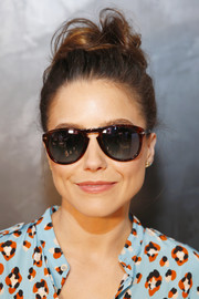 Sophia Bush styled her tresses into a messy top knot for Sunglass Hut's Made for Summer event.
