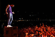 Chris Brown performed his signature moves while wearing a pair of classic Adidas sneakers.