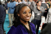 Simone Biles styled her hair into a half updo for the Super Bowl 51 opening night.