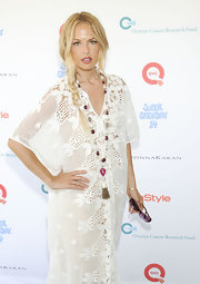 Rachel Zoe donned a lacy white frock for the OCRF benefit in New York. She paired the look with a beaded necklace and a loose side braid.