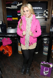 Cassie Scerbo bundled up at the Superdry Lounge Party in a pair of black leather mid-calf boots.