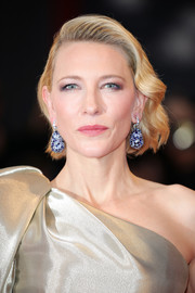 Cate Blanchett accessorized with a pair of chunky gemstone earrings by Chopard.
