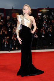 Cate Blanchett cut a regal figure in a black and gold one-sleeve gown by Armani Privé at the Venice Film Festival screening of 'Suspiria.'