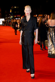 Tilda Swinton styled her suit with towering black platforms.