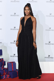 Naomi Campbell was a goth beauty in a black Azzedine Alaïa halter gown at the Swarovski Crystal Wonderland party.