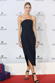 Martha Hunt went minimalist in a strapless navy midi dress at the Swarovski Crystal Wonderland party.