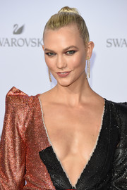 Karlie Kloss styled her hair into a tight bun for the Swarovski Crystal Wonderland party.