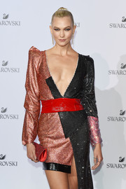 Karlie Kloss paired a red crystal clutch with an equally sparkly dress for the Swarovski Crystal Wonderland party.