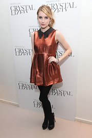 Emma Roberts glittered at the Swarovski soiree in NYC. She topped off her look with black tights and black criss-cross sandals.