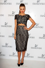 Miranda Kerr paired her dress with classic bow-embellished black pumps.