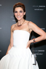 Clotilde Courau styled her simple white dress with a floral cuff for the Swarovski and Viktor & Rolf party during the Cannes Film Festival.