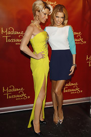 Sylvie van der Vaart posed with her wax figure in a chic white and blue colorblocked dress.