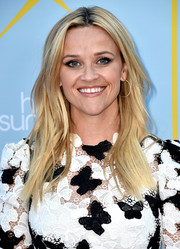Reese Witherspoon sealed off her look with classic gold hoops.