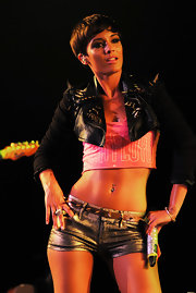 Frankie Sandford showed off her incredibly well-toned abs in a pink crop top and a tiny studded leather jacket.