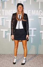 Anna dello Russo was edgy-preppy in a black leather moto jacket teamed with a white shirt and a tie during the Salone Internazionale del Mobile celebration.