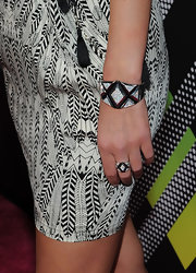 Nicky Hilton accessorized her look with a gemstone encrusted bangle bracelet and matching ring.