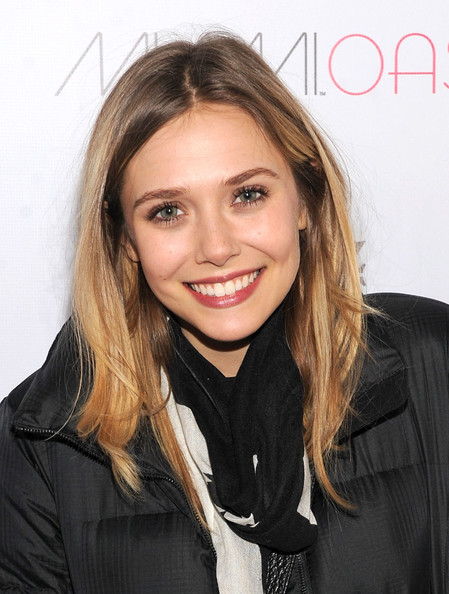 Elizabeth Olsen wore a sheer shade of rich raspberry lip color while in Park City, Utah.
