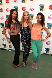 Heidi Range posed with her group wearing a dotted jumpsuit at the T4 on the Beach event.