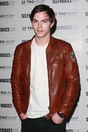 Nicholas Hoult showed off his cool leather jacket while attending the Tag anniversary party.