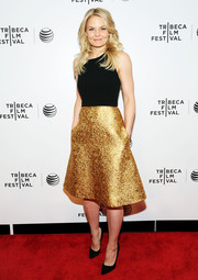 Jennifer Morrison was a style standout at the TFF Awards in a Romona Keveza halter dress with a fitted black bodice and an embossed gold skirt.