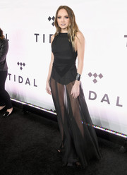 Danielle Bradbery showed her more daring side with this sheer black gown with a built-in bodysuit while attending Tidal X: 1015.
