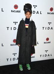 Willow Smith arrived for the TIDAL X benefit concert wearing a long charcoal coat.