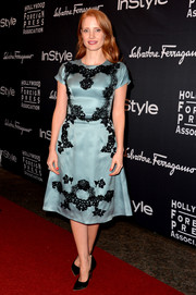 Jessica Chastain went the ultra-ladylike route at the TIFF HFPA/InStyle party in a petrol-blue Dolce & Gabbana cocktail dress with black lace accents.