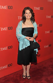 Michele added color to her look at the 100 Times Gala with an aqua shawl.