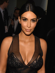 Kim Kardashian played up her gorgeous eyes with lots of shimmery gold shadow.