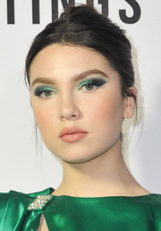 Maya Henry matched her eyeshadow to her emerald-green dress.