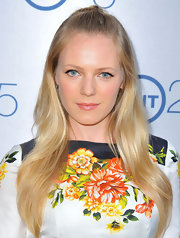 Can't decide between and updo or flowing waves? Take a tip from Emma Bell who donned the ever-classic half updo.