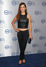 Julie opted for simple black skinny pants to pair with her leather top for a mix of classic and edgy style.