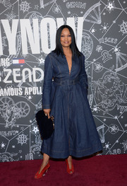 Garcelle Beauvais paired her frock with an oversized frame clutch.