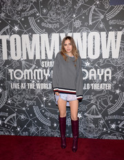 Suki Waterhouse styled her look with a pair of burgundy knee-high boots.