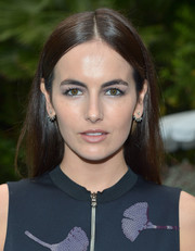Camilla Belle sported a simple center-parted style at the Topman Magazine 'This is Tailoring' issue celebration.