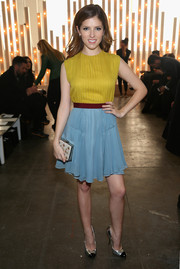 Anna Kendrick sported a lovely color combo at the Jenny Packham fashion show in a sleeveless yellow and blue cocktail dress from the brand.
