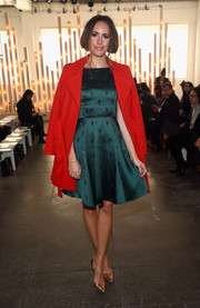 Louise Roe went for classic elegance with this beaded green fit-and-flare dress during the Jenny Packham fashion show.