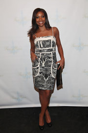 Gabrielle union complemented a black and white print dress with black leather platform pumps.