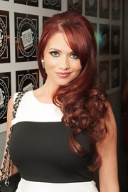 Amy Childs attended the 2012 TRIC Awards wearing her hair in long curls with side-swept bangs.