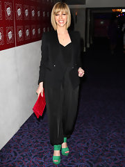 Kate donned a sophisticated black blazer with high-waisted harem pants and bold colored accessories for the TRIC Awards.
