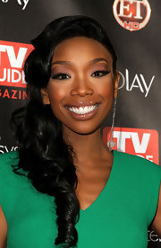 Brandy offset her kelly green dress with metallic rose eyeshadow and wispy lashes. She finished off her look with a touch of lip gloss.
