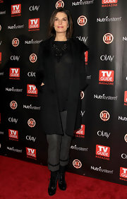 Sela Ward showed off her high heels patent oxcords with cropped gray trousers.