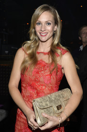 A.J. Cook attended the TV Guide Magazine Hot List Party carrying an elegant gold snakeskin clutch.