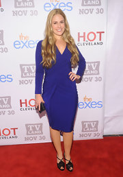 Cacee Cobb donned a royal blue knit dress with a gathered bodice for the TV Land Holiday Premiere Party.